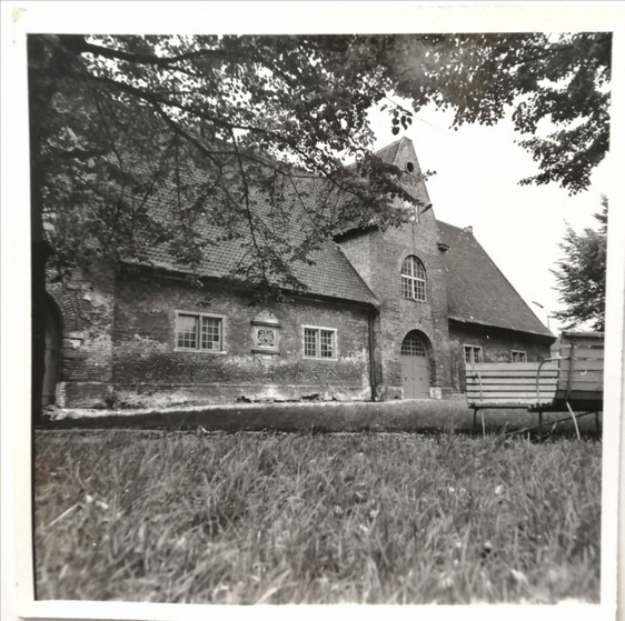 Gdańsk. The Small Armoury. Archive black-and-white photographs. A historic brick building of the former arsenal located at the Old Suburb of Gdańsk. The photograph presents the side of the brick building seen from a garden.