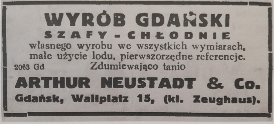 The photograph presents an archival press announcement. It says: Made in Gdańsk. Cooler-cupboards of our own production. All sizes. Low ice consumption. First-class references. Surprisingly cheap. Artur Neustadt & Co. Gdańsk, Wallplatz 15, (kl. Zeughaus).