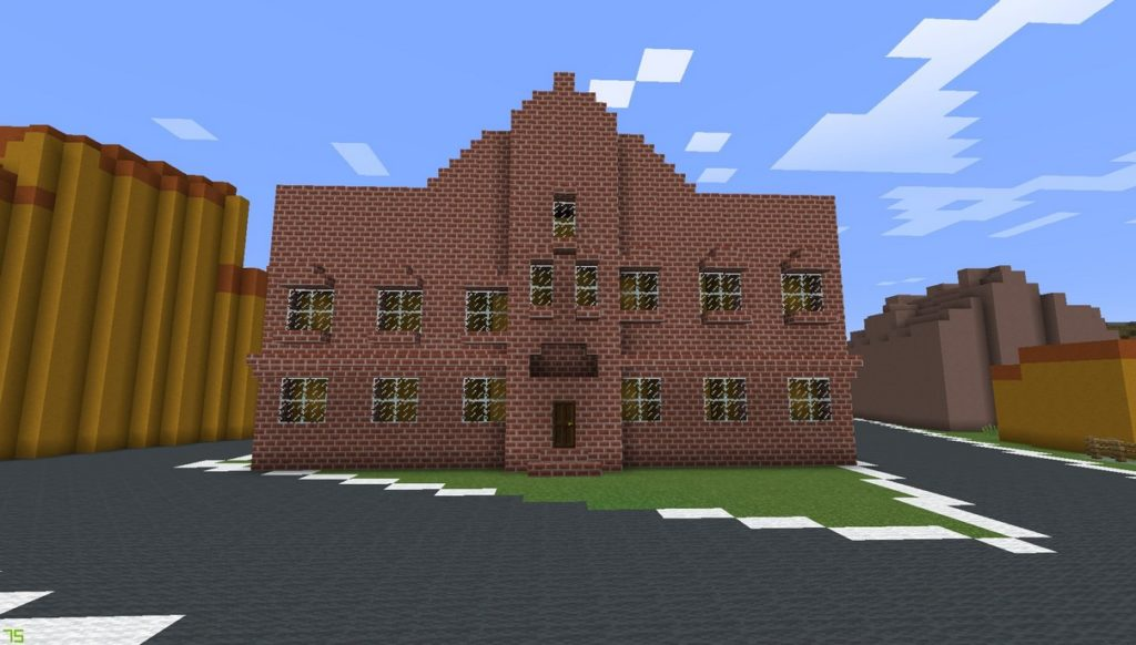 Gdańsk. The city pawnshop. Minecraft visualisation. The photograph presents the front of the building constructed from brick blocks. The object features numerous windows and it is surrounded by a road constructed from dark grey block. In the background there are some buildings.